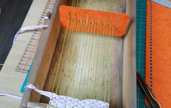 métier à tisser avec peigne envergeur